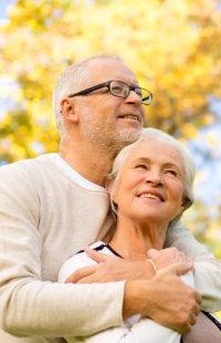 senior man hugging his wife