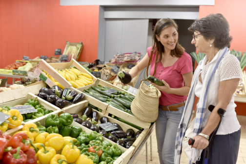 patient smiling while caregiver buying fruits