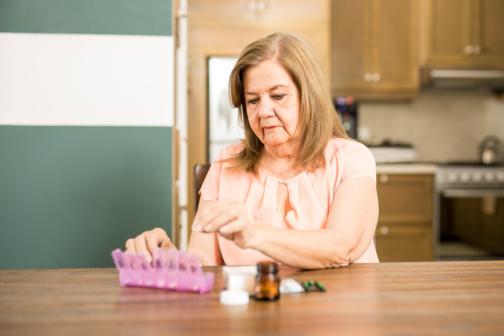 senior patient with her medicines