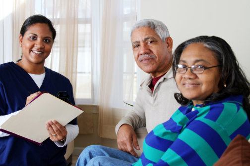 caregiver checking the two senior couple