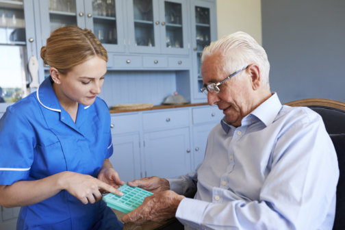 senior patient and caregiver talking