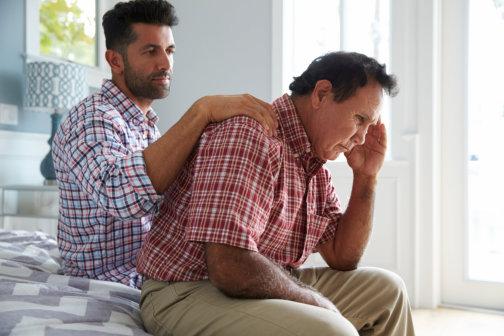 caregiver talking to his senior patient