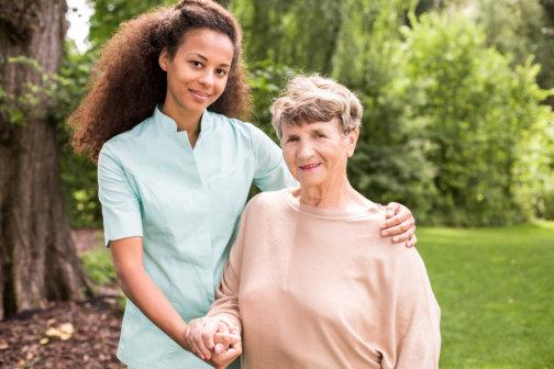 senior patient and caregiver smiling