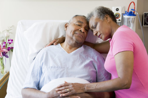 senior patient and his wife sleeping
