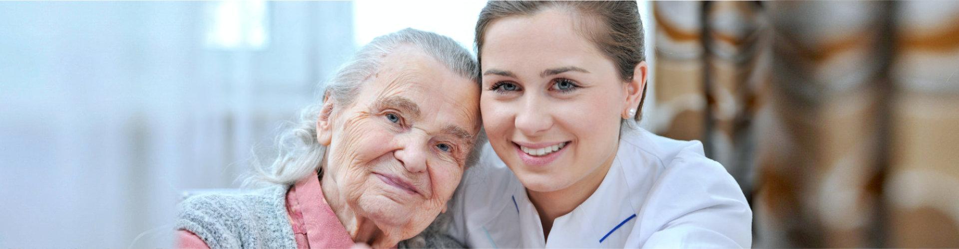 beautiful caregiver and senior woman smiling